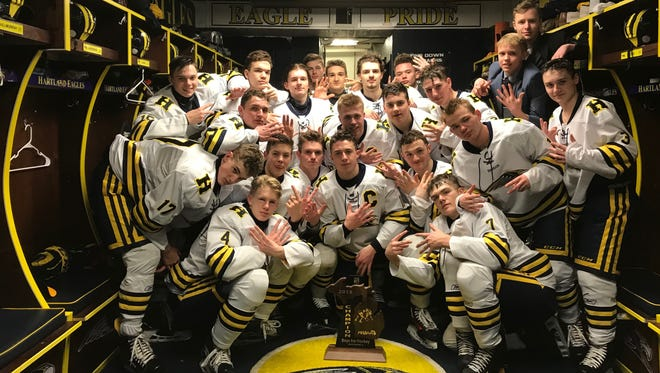 Hartland's hockey team celebrates a seventh straight regional championship after beating West Bloomfield, 9-0, on Saturday, March 3, 2018.