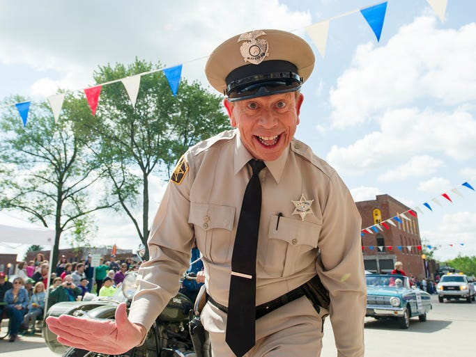 David Browning, Bristol, Virginia, portrays The Mayberry Deputy in the parade that kicked off the weekend festival. Danville hosted the inaugural Mayberry in the Midwest Festival Saturday, May 17, 2014, where a troupe of tribute artists protrayed the iconic cast members of the popular TV series The Andy Griffith Show. Grand Marshal of the event's parade was former cast member of the show Maggie Peterson who played Charlene Darling.
