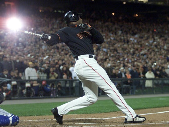 10/5/2001 -- San Francisco, CA --  San Francisco Giants slugger Barry Bonds swings and hits his 71st home run with camera flashes popping from the stands on his first at bat against the Los Angeles Dodgers Friday, October 5, 2001 breaking the Major League home run record set by St. Louis Cardinals Mark McGwire.  (PHOTO BY Jack Gruber/USA Today) ORG XMIT: BONDS_ JG5071 ORG XMIT: Q1P-0311081041297245 (Via MerlinFTP Drop)