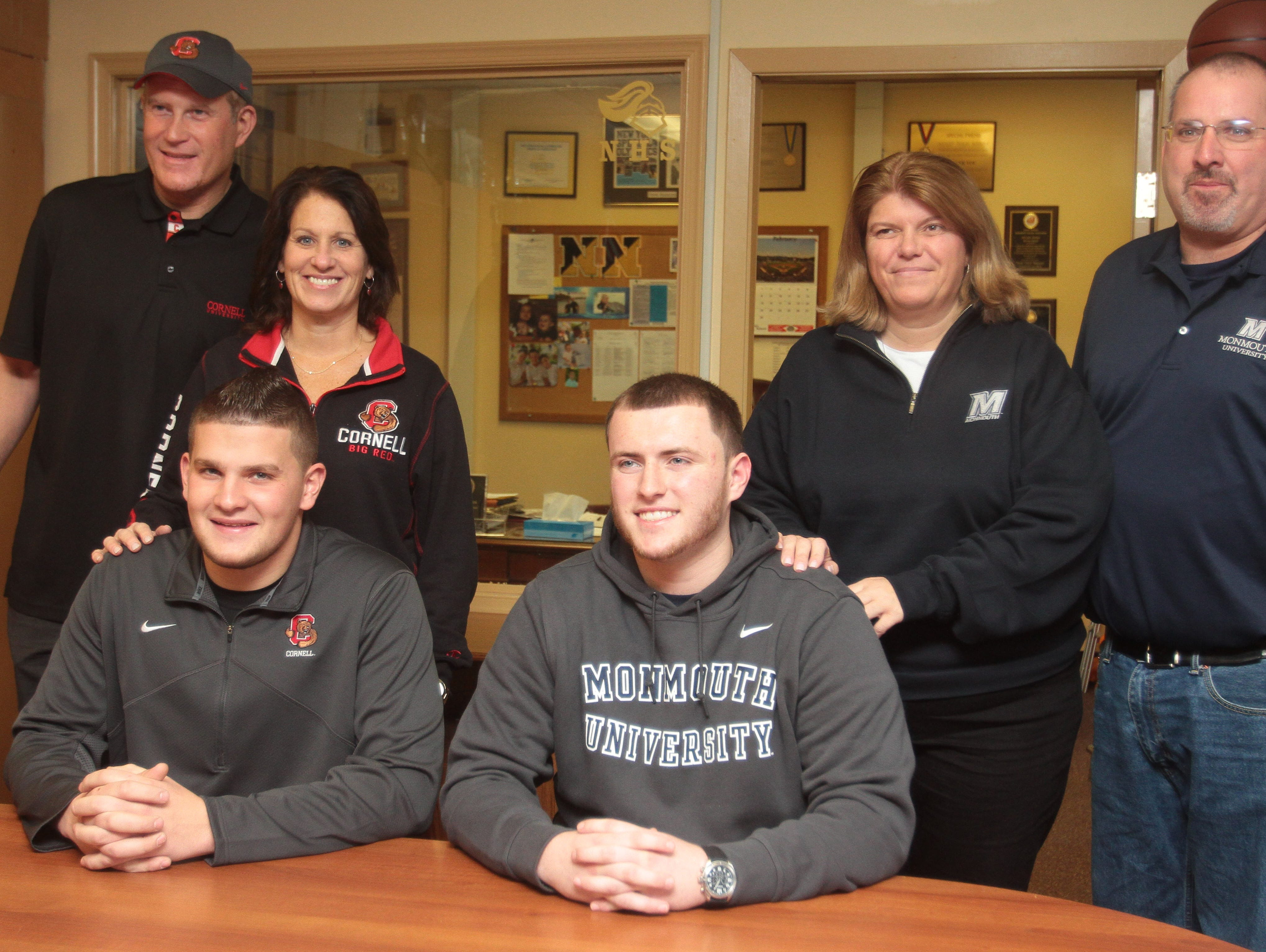 Jordan Landsman (front left) and Brian Syracuse (front right) with their parents on National Signing Day Feb. 3, 2016 at Nanuet Senior High School.