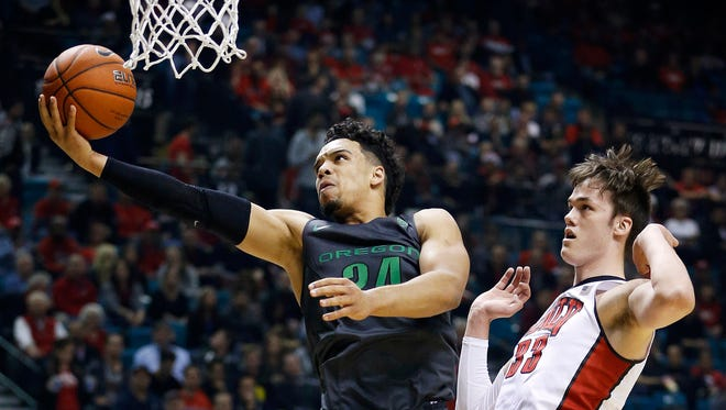 Oregon forward Dillon Brooks shoots around UNLV forward Stephen Zimmerman Jr. during the first half of an NCAA college basketball game Friday, Dec. 4, 2015, in Las Vegas.
