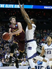 Clayton Custer looks to pass against Kansas State.