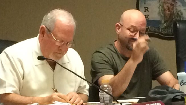 Estero Planning and Zoning Board member David Crawford and Design Review Board member Joe McHarris consider plans for village downtown during public hearing Wednesday.