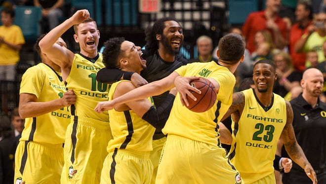 Oregon Ducks players celebrate after the championship game of the Pac-12 Conference tournament against the Utah Utes at MGM Grand Garden Arena.
