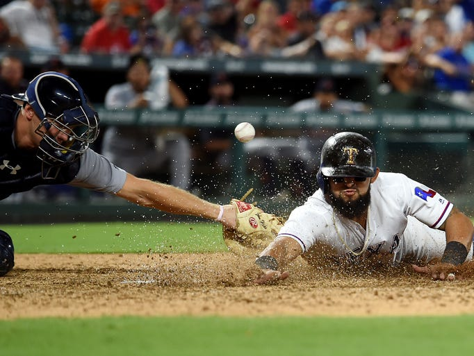 Texas Rangers second baseman Rougned Odor (12) steals