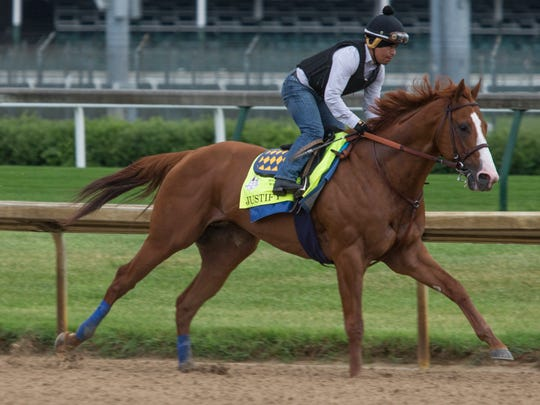 Triple Crown contender Justify works out at Churchill Downs on Tuesday.