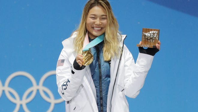 Chloe Kim celebrates during the medal ceremony.