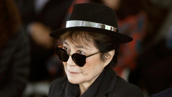 In a Friday, June 12, 2015 file photo, artist Yoko Ono appears during a ceremony announcing the future installation of Ono's first permanent public art installation in the U.S., in Chicago.