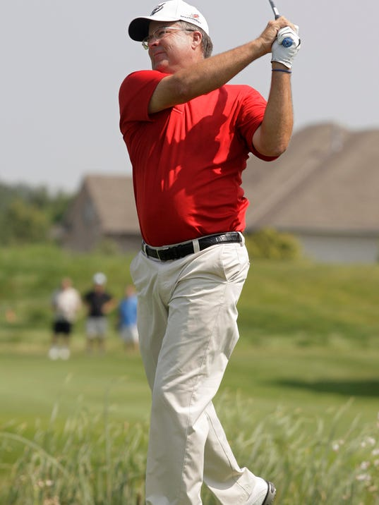 Kenny Perry hits his drive off the first tee during the second round of the Champions Tour's 3M Championship golf tournament at TPC Twin Cities in Blaine, Minn., Saturday, Aug. 2, 2014. AP Photo/Paul Battaglia)