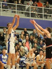 McNary's Lucas Garvey hits a 3-pointer against McMinnville