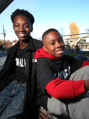 Ki'Anthony Tyus, 10, right, and Diontae Reed, 14, live in the Shawnee neighborhood.  They are part of the Hood 2 Hood campaign to end violence in the community. The two survived separate shootings earlier this year.