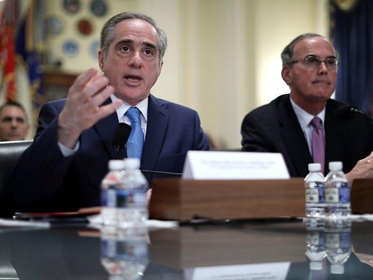 Veterans Affairs Secretary David Sulking, left, testifies