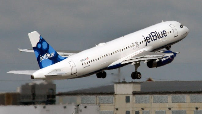 A JetBlue plane takes off from from an airport in South Florida in this file photo from Oct. 26, 2009.