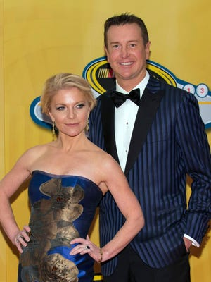 Kurt Busch and Patricia Driscoll arrive at the NASCAR Sprint Cup Series awards ceremony on Dec. 6, 2013, at the Wynn Resort & Casino in Las Vegas.