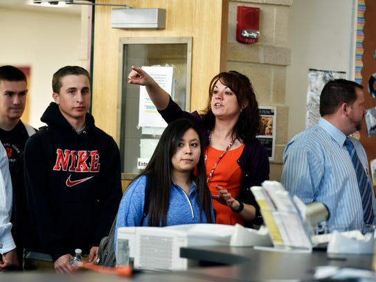 Central York teacher Erin Walker directs incoming students
