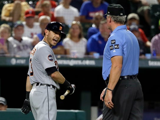 Tigers second baseman Ian Kinsler, left, argues with