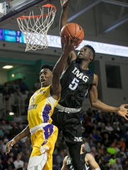 Montverde Academy's RJ Barrett is guarded by IMG Academy's Emmitt Williams in the semifinals of the 44th Annual Culligan City of Palms Classic at Suncoast Credit Union Arena on Tuesday in south Fort Myers.