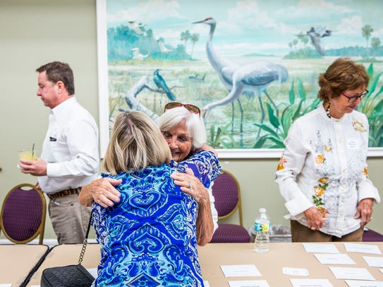 Barb Goodlette, left, and Chig Rice greet each other