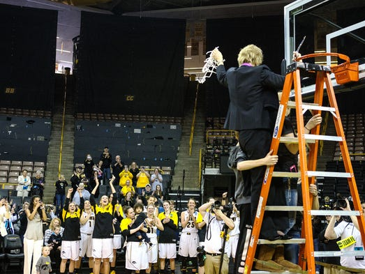 Iowa head coach Lisa Bluder celebrates with the team