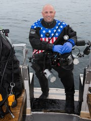 Andy Morrison after a dive in Lake Huron's NOAA Thunder Bay National Marine Sanctuary, Alpena, Michigan.
