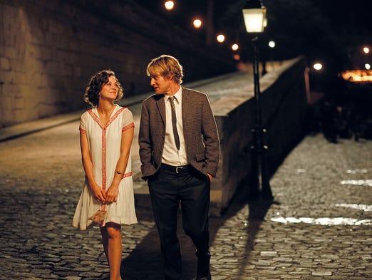 "Marion Cotillard and Owen Wilson in a scene from the Woody Allen film ""Midnight in Paris."""