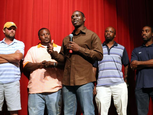 Former NFL player and member of the 1994 Riverdale champion football team Fernando Bryant, center, speaks during a twenty year reunion of the team Thursday, July 17, 2014 at Riverdale High School. Other former players are, from left, Matt Austin, Marcus Smith, Larry Floyd and Jerome Verge.
