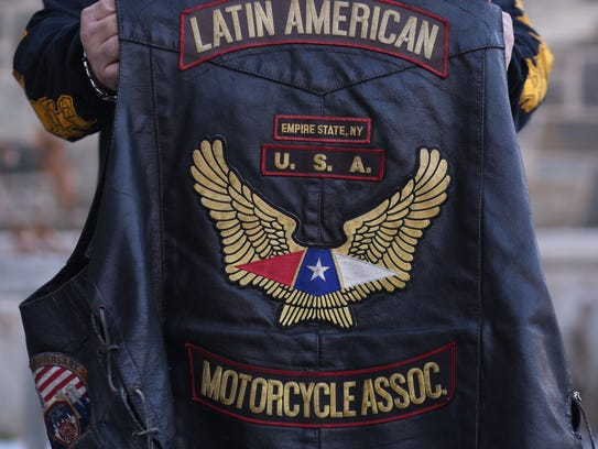 "Mike Montalvo, president of the Empire State chapter of the Latin American Motorcycle Association, holds his ""colors"" on Wednesday."