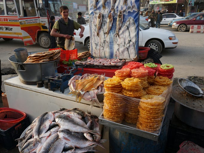 Street vendors selling fish on the streets of Kabul. Street vendors, restaurants and stores in Kabul have been struggling to make ends meet in the past year as the security situation remains uncertain.