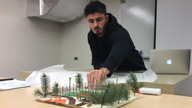 Samuel Rancoud-Guillon, a junior at UVM, discusses his model of a soccer cage he proposes for Pomeroy Park in Burlington during a design class presentation. Photographed Dec. 7, 2017.