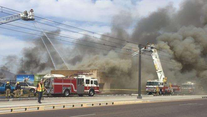 Phoenix fire crews battle a large fire near 2800 E. Washington Street.