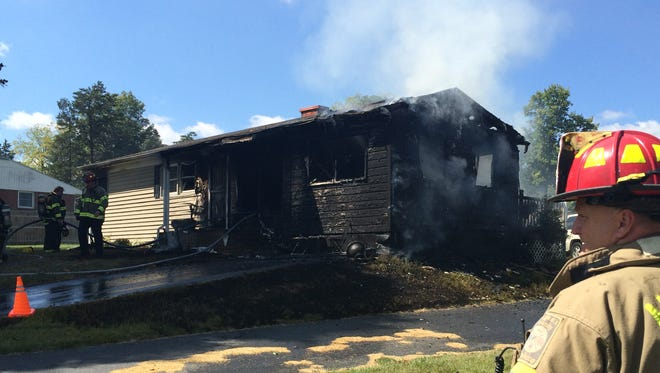 A fire heavily damaged a home Friday afternoon at 500 Pleasant Grove Road.