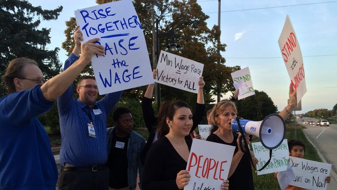 Members of the Center for Worker Justice of Eastern Iowa demonstrate in support of a higher minimum wage Oct. 7, 2015, outside City Hall in North Liberty.