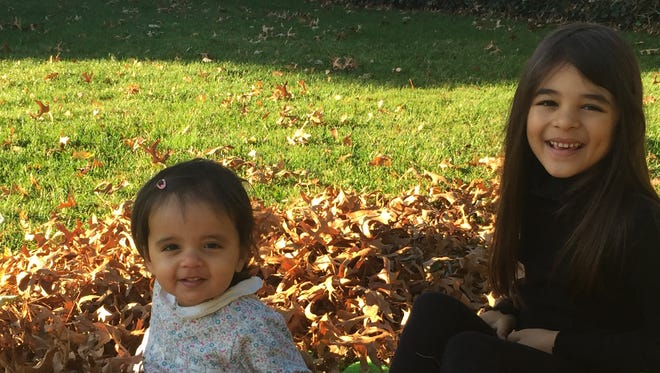 Lily, 7, and Juliet Santana, 16 months, will spend Thanksgiving with relatives. Lily will participate as the family prepares for the holiday.