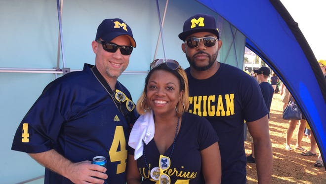 Toni Jones, middle, and Marlon Jones, right, before Michigan plays Florida in the Citrus Bowl on Jan. 1, 2016.