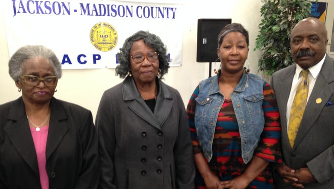 Macye Chatman, Mary Williams and Sharon Green with Harrell Carter, president of the Jackson-Madison County branch of the NAACP, during a Founders' Day celebration on Friday.