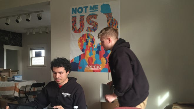 Democratic presidential candidate Bernie Sanders has opened an Indianapolis campaign office in Broad Ripple at 6367 Guilford Ave. Campaign workers Shaddi Zeid, left, and Simon Bracey-Lane, right, sign up volunteers on March 22.