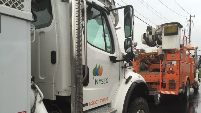 NYSEG bucket trucks on the way to day's assignment. The utility's rates will rise next month following an expected approval by the Public Service Commission of a revised rate plan.