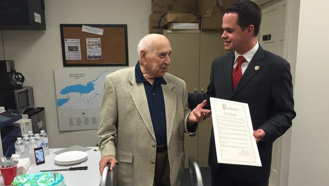 From left, state Sen. David Carlucci, D-Clarkstown, hands Albert Penchansky, of Monsey, a special proclamation from the state Senate recognizing his 101st birthday. Penchansky is a World War II veteran who went on to become a CPA.