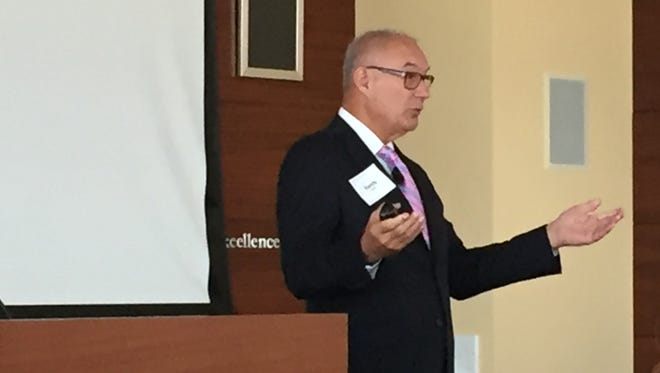 Former Walgreens executive Randy Lewis told a group of business leaders Monday at Old National Bank that disabled people are untapped resource.