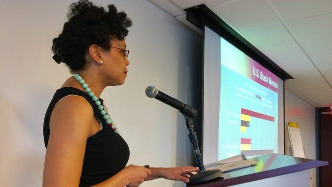 ASU Community Relations Director and Black Philanthropy Initiative member Kenja Hassan presenting HIV data