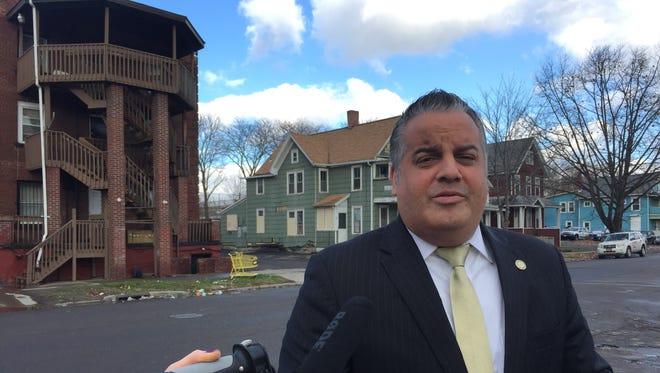 Binghamton Mayor Richard David announces the condemnation of 129 Susquehanna St., left.