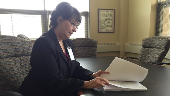 Anderson Township Administrator Vicky Earhart reviews a stack of letters mailed to the township by Sherwood Elementary School students.