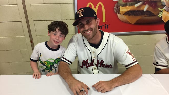Detroit Tigers left-hander Matt Boyd with a young fan as he works his way back at Triple-A Toledo.