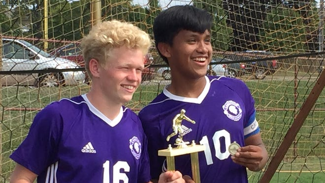 Lakeview sophomores Will Shenefield and Javier Carrillo pose with the 2017 All-City Soccer Tournament trophy on Saturday at Battle Creek Central High School.