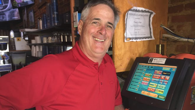 Mike Cleary, owner of Cleary's Pub in Howell, with the lottery machine. A customer purchased a Powerball ticket at the establishment on Jan. 3. A drawing a week later determined that person won $250,000, but the prize is yet unclaimed.
