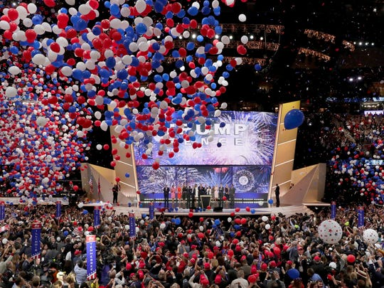 Republican Presidential Candidate Donald Trump, and Republican Vice Presidential Nominee Gov. Mike Pence of Indiana watch with their families as the balloons fall during the final day of the Republican National Convention in Cleveland Thursday.
