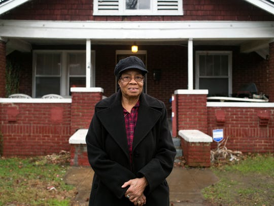 "Gloria Hunter stands in front of the home she and her husband bought before he died the late 1980s. ""I'm retired, and I don't draw a whole lot of money and that house was supposed to be sort of backup money to help me in my retirement,"" Hunter said."