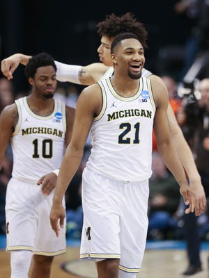 Michigan guard Zak Irvin (21) celebrates the 92-91 win against Oklahoma State on March 17, 2017 at Bankers Life Fieldhouse in Indianapolis in the NCAA tournament.