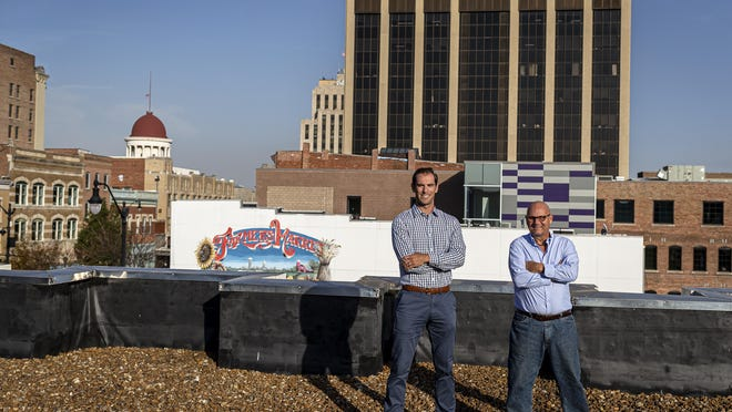 David Lee, left, and Tony Caccomo, right, are bringing the city it's first rooftop bar with panoramic views of downtown Springfield that include views of both the the Old State Capitol as well as the Illinois Capitol with the development of the The Public Market at Fourth and Adams streets. Along with the rooftop bar The Public Market will have several food vendors and bars as well as a ground level beer garden.