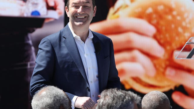 In this file photo, Steve Easterbrook, then CEO of McDonald's Corp., greets people in the crowd in 2018, before the grand opening of McDonald's new headquarters in Chicago's Fulton Market district. McDonald's Corp. filed suit against its ousted leader, Easterbrook, alleging his termination last fall over a relationship with an employee shouldn't have included severance pay.